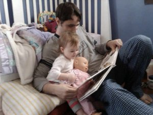 Josh sharing a bedtime story with Fiona.
