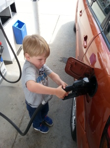My eldest son, Asher pumping gas like a big kid